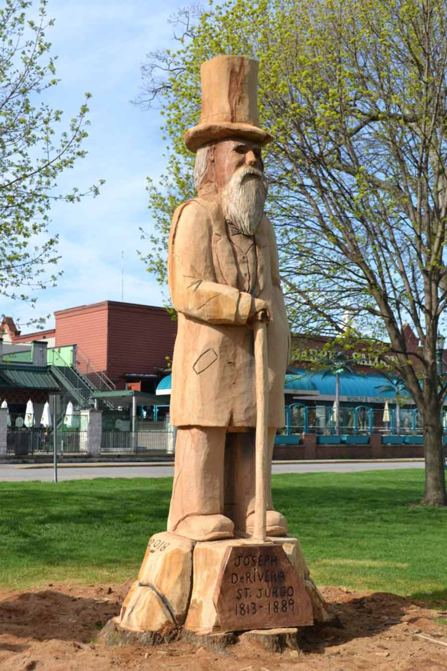 Put-in-Bay Parks - A photo of the completed tree carving monument of history maker Jose DeRivera at the Put-in-Bay Park.